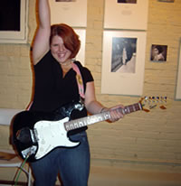 Girl Rocker with Black Stratocaster